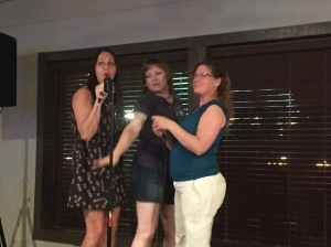 Some of the SQL ladies having a good time at karaoke.
